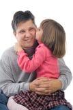 Descendant embrassant le père Photographie stock libre de droits