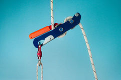 Descender on the rope with carabiner Stock Image