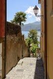 Descending alley at Varenna, Italy Stock Photos