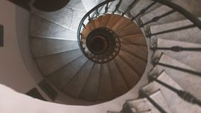 Descending along an ancient spiral staircase stock footage