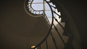 Descending along an ancient spiral staircase