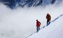 Descending alpinists Royalty Free Stock Images
