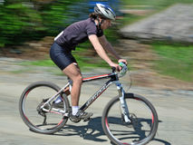 Descending bike rider - motion blur Stock Photos