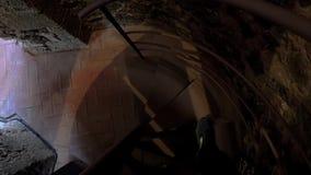 Descending dark narrow spiral staircases.  stock video footage