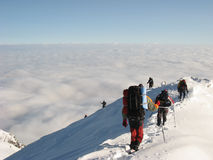 Descending down snowy mountain peak Royalty Free Stock Photos