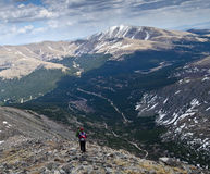 Descending down snowy mountain peak stock photos