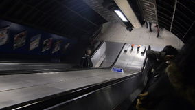 Descending an Escalator. At a railway station in London stock video