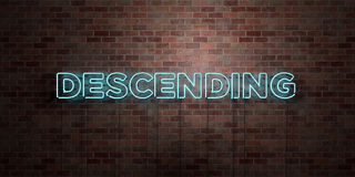 DESCENDING - fluorescent Neon tube Sign on brickwork - Front view - 3D rendered royalty free stock picture. Can be used for online banner ads and direct Royalty Free Stock Photo