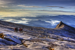 Descending Mount Kinabalu. Climbers approaching South Peak while descending Mount Kinabalu Stock Photography