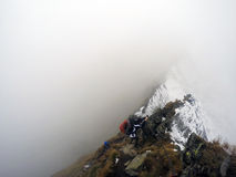 Descending from the mountain through bad weather Stock Photo