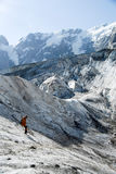 Descending mountaineer. Mountaineer crossing ice canyon on a sunny day Royalty Free Stock Photography