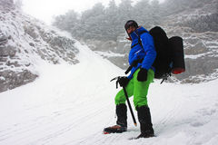 Descending from Piatra Craiului ridge on a very cold winter day Stock Photo