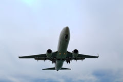 Descending plane to land at the airport Stock Photo