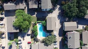 Descending on a pool: aerial view stock footage