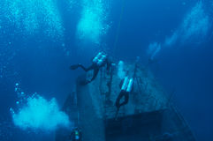 Descending Scuba Divers. Scuba divers descending on the  M/V Lourdis that was sunk purposely as an artificial reef in Deerfield Beach, Florida. Scuba divers in Stock Image