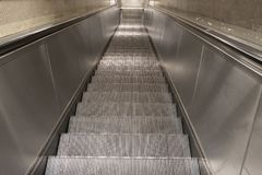 Descending escalator. Descending sliding scale, view from above Stock Image