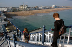 Descending steep steps on a pier. Eastbourne UK. Descending high steps on Eastbourne Pier UK. Could be used to highlight fear of heights or vertigo or more Stock Image
