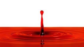 Descenso de la macro del vino rojo con el efecto de foco (descenso 1 - pizca lateral Imagen de archivo libre de regalías