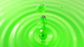 Descenso de la macro del zumo de manzana con el efecto de foco (descenso 2) Foto de archivo libre de regalías