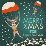 Descenso de los renos de la Navidad por el paracaídas Fotografía de archivo