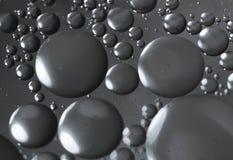 Descensos del aceite en superficie del agua Imagen de archivo libre de regalías
