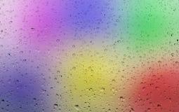 Descensos del agua en fondo del color Fotografía de archivo
