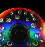 Descensos del agua en un CD foto de archivo