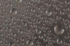 Descensos metálicos del agua imágenes de archivo libres de regalías