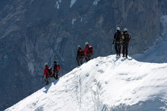 Descent. Climbers descent over a snow ridge Royalty Free Stock Photos
