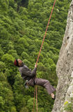 Descent. Climber abseiling a wall in the Cerna Valley, near Baile Herculane, Romania Stock Photo