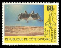 Descent space module, operation Viking. Cote d`Ivoire - CIRCA 1981: Stamp printed by Cote d`Ivoire, Multicolor memorable edition on the topic of Space conquest Royalty Free Stock Photos