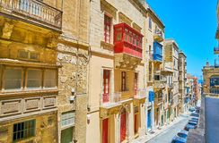 The descent in St Ursula street, Valletta, Malta. The view from the upper terrace on the gentle descent in St Ursula street with line of old edifices, with Stock Images