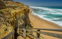 Descent of the stairs to the beach to the Pacific ocean near the. 12 apostles Royalty Free Stock Image