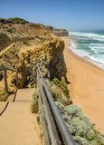Descent of the stairs to the beach to the Pacific ocean near the. 12 apostles Royalty Free Stock Images