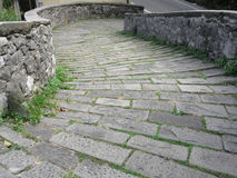 Descent stone walkway of medieval bridge known as Ponte del Diavolo in Borgo a Mozzano, Italy Royalty Free Stock Photography