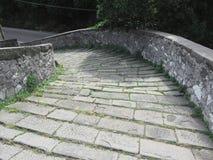 Descent stone walkway of medieval bridge known as Ponte del Diavolo in Borgo a Mozzano, Italy Stock Photography