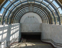 Descent into the subway. A wide staircase and a glass roof in form of an arch Royalty Free Stock Photography