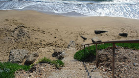 Descent to the Beach. Steps descent to the beach Stock Photography