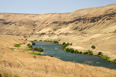 Deschutes River. Surrounded by eastern Oregon desert hills stock image