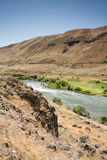 Deschutes River. Surrounded by eastern Oregon desert hills stock photography