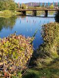 Deschutes River at the Old Mill District. The beautiful Deschutes River flows through the Old Mill District in Bend in Central Oregon on a beautiful Fall morning royalty free stock image