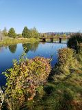Deschutes River at the Old Mill District. The beautiful Deschutes River flows through the Old Mill District in Bend in Central Oregon on a beautiful Fall morning royalty free stock photography