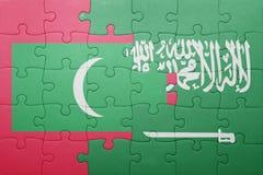 Desconcierte con la bandera nacional de la Arabia Saudita y de Maldivas Foto de archivo