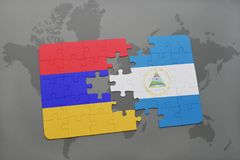 desconcierte con la bandera nacional de Armenia y de Nicaragua en un mapa del mundo Imagen de archivo libre de regalías