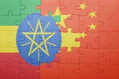 Desconcierte con la bandera nacional de China y de Addis Ababa Imágenes de archivo libres de regalías