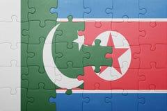 Desconcierte con la bandera nacional de Corea del Norte y de Paquistán Fotografía de archivo libre de regalías