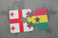 desconcierte con la bandera nacional de Georgia y de Ghana en un mapa del mundo Fotografía de archivo libre de regalías