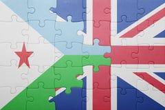 desconcierte con la bandera nacional de Gran Bretaña y de Djibouti Imagen de archivo libre de regalías