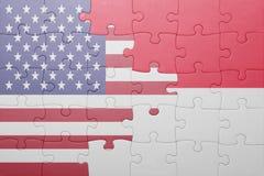 Desconcierte con la bandera nacional de los Estados Unidos de América y de Indonesia Fotografía de archivo libre de regalías