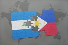 desconcierte con la bandera nacional de Nicaragua y de Filipinas en un mapa del mundo Imagen de archivo libre de regalías
